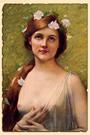 Юная девушка с цветами в волосах